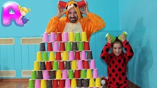 Anna and dad Play with colored cups