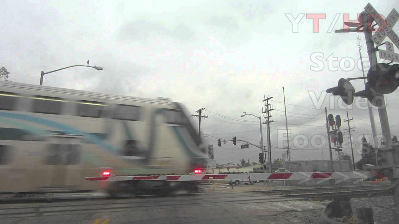 MetroLink Train Crossing Track u0026 Sound Signals / Guard Rail Flashing Lights | HD Stock Video Footage & MetroLink Train Crossing Track u0026 Sound Signals / Guard Rail ... azcodes.com