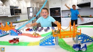 We built a giant Magic Tracks course in our house that goes over a ...