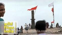 Historic Shiva temple IN the sea with devotees, near Bhavnagar