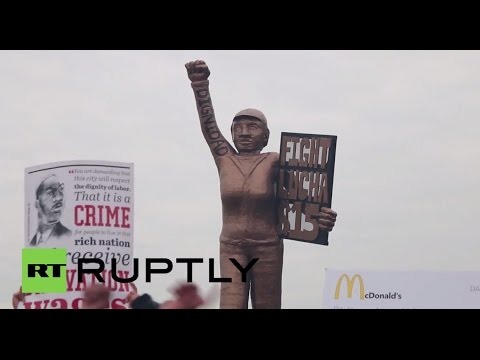 USA: THOUSANDS of McDonald's workers march for $15 per hour