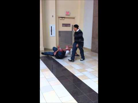 Newport Mall. Jersey City, NJ. Secuirty guard chokes out shopper & puts man into a wrestling move.