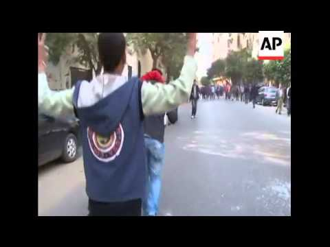 Egyptian riot police firing tear gas and rubber bullets stormed into Cairo's Tahrir Square Saturday
