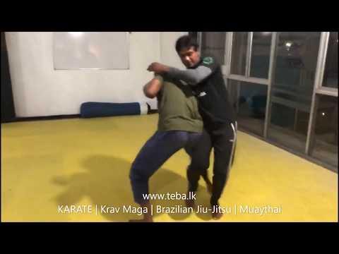 KRAV MAGA TRAINING • How to escape from the Headlock ( Bar Arm)