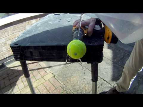 Water retained by a spinning tennis ball