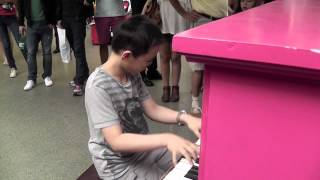 Rather talented lad on public piano at St Pancras International Station, London