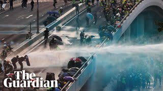 Hong Kong: police fire teargas after protesters throw molotov cocktails at government HQ