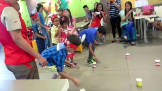 Cups and popsicle stick birthday party game at jollibee