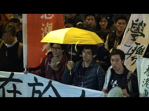 Hong Kong police haul away protesters from rally site
