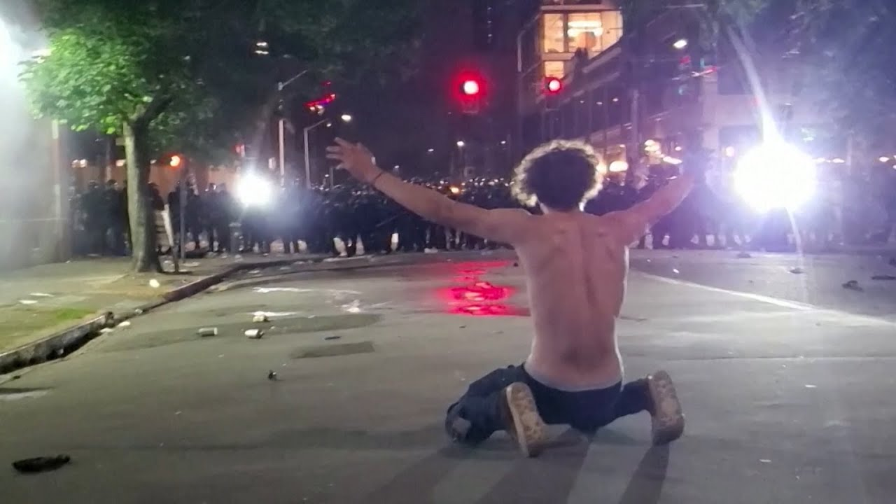 National Guard fire tear gas and firecrackers at close range in Seattle Black Lives Matter protest