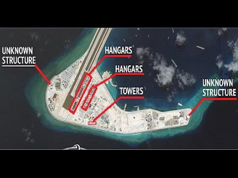 Satellite photos reveal Beijing is building aircraft hangars for its fighter jets on islands in So