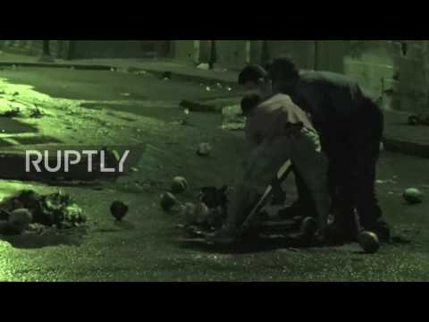 Venezuela: Protesters face off with guns and fireworks in battle for Caracas