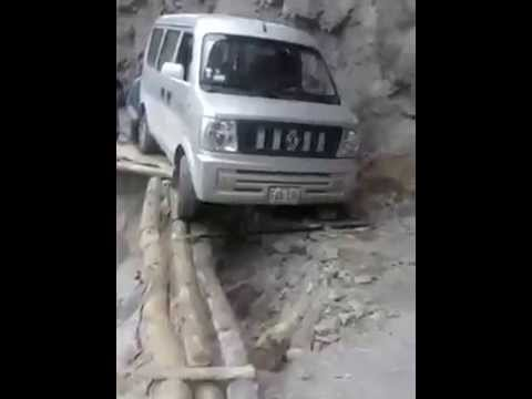 crazy-van-driving-on-wooden-beams-Peru