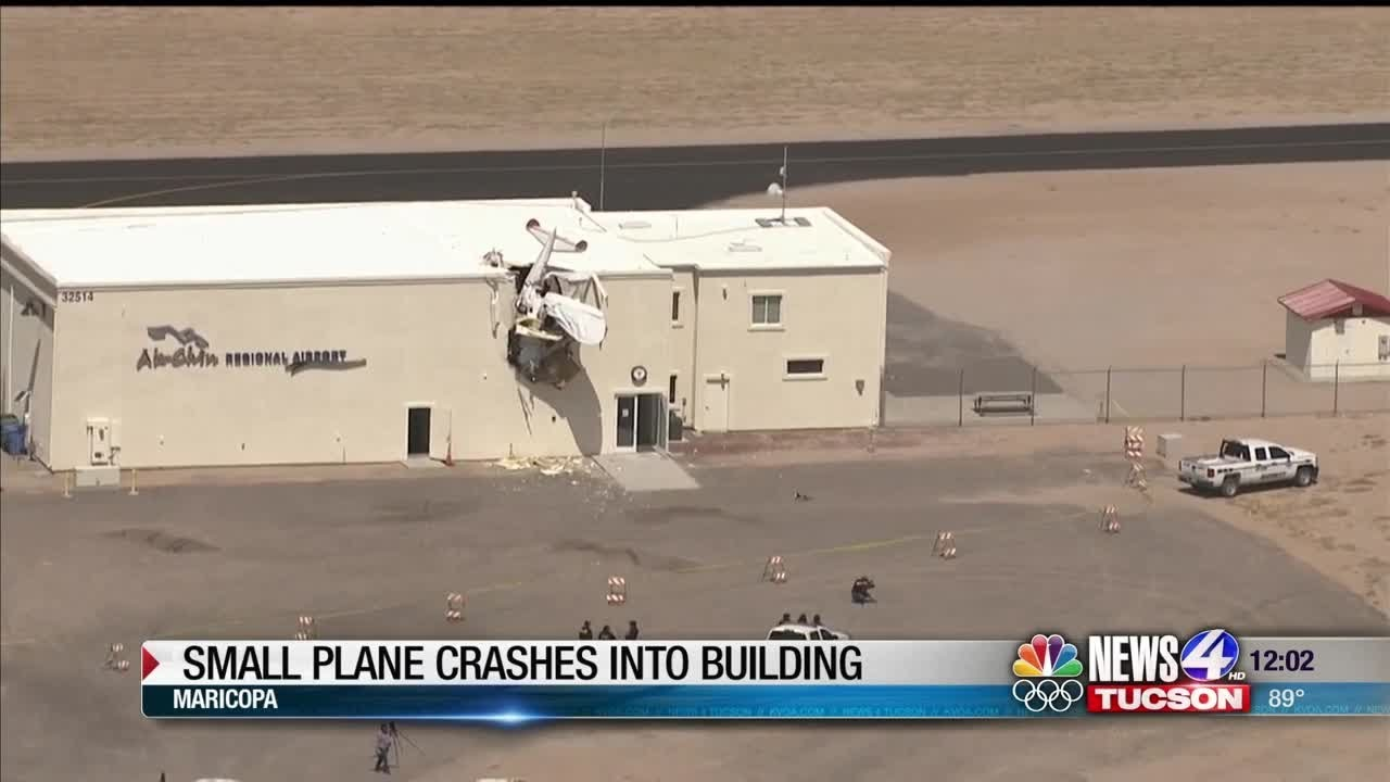 Small plane crashes into building