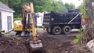 Loading a 10 Wheel Dump Truck with a Cat 308D
