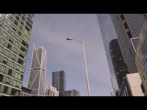 Driving by San Francisco financial district skyline office buildings - Free Stock Footage