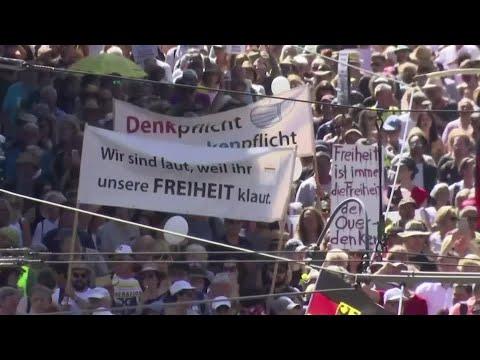 Thousands march in Berlin against coronavirus measures 1