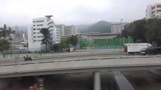 Gambar cover Outside view into city on Hong Kong MTR Subway East Rail Line