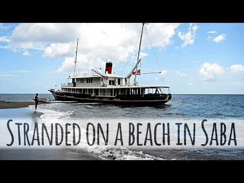 Stranded on a beach in Saba— Sailing Uma [Step 83]