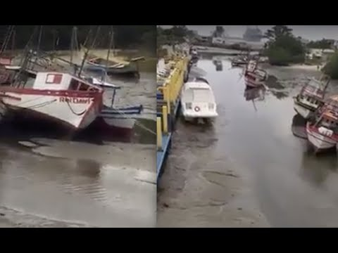 Water retreats again in coastal South America - Boats sitting in mud!