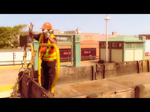 R252 flatbed car transfer with friendly worker