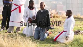 Mid shot of members of the Twelve Apostles Church of Chri...
