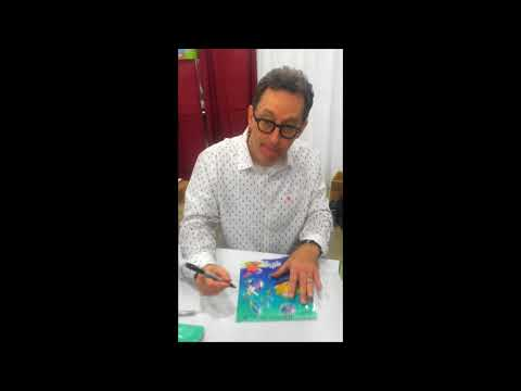 Voice actor Tom Kenny signing autographs