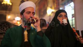 Stock Footage - Portrait of Islamic Couple, Smoking Shisha | VideoHive