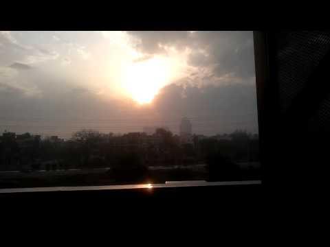 SUN BEHIND D CLOUDS