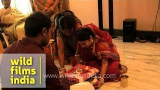 Bengali bride receive gifts during Bou Bhaat ceremony
