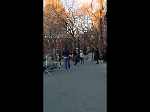 Kids playing with toy cars on Washington Square Park