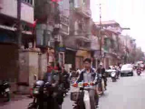 Vietnam, Hanoi - crazy traffic on a motorbike