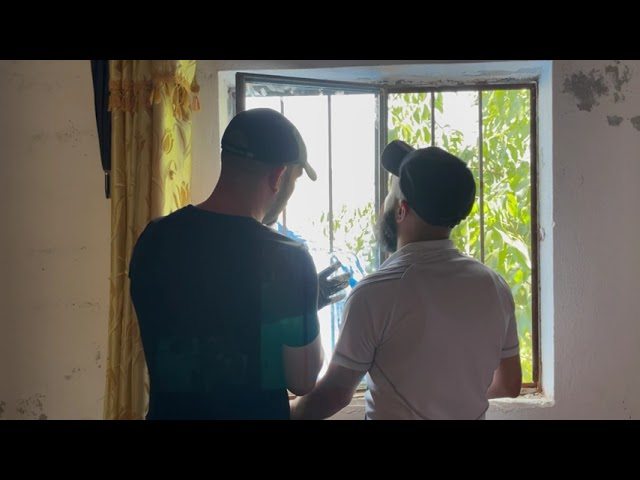 218 - Repairing home windows after being shattered due to Turkish airstrikes in Mosaka
