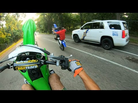 WHEELIEING DIRTBIKES PAST COPS !