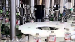Envasadora célula de carga com tampador   Alcatek Máquinas