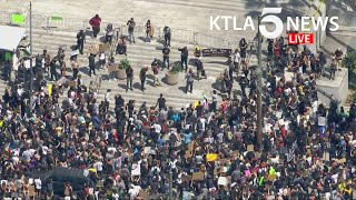 Crowds continue to march through downtown Los Angeles in protest of George Floyd killing