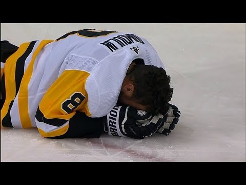 Dumoulin exits game after collision with Wilson and Ovechkin