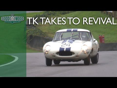 Tom Kristensen slides Jaguar E-type round soaking Goodwood