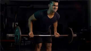 Closeup shot of a young Indian man doing barbells deadlift exercise