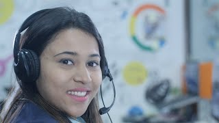 Indian call center employee / operator smiles at the camera