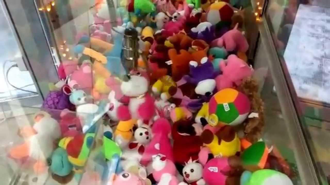 Как выигрывать( вытаскивать) в автомате с игрушками .