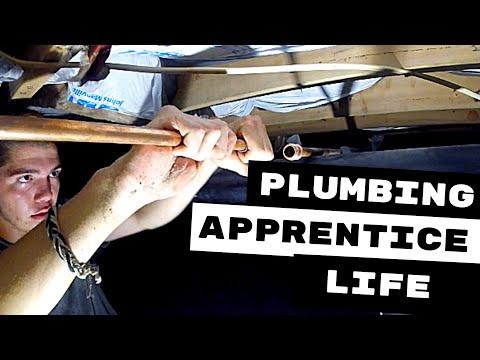 plumbing-apprentice-plumbs-hose-bibb-in-crawl-space
