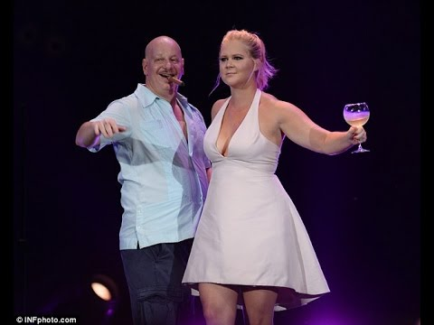 Amy Schumer Sips From A Wine Glass On Stage During The