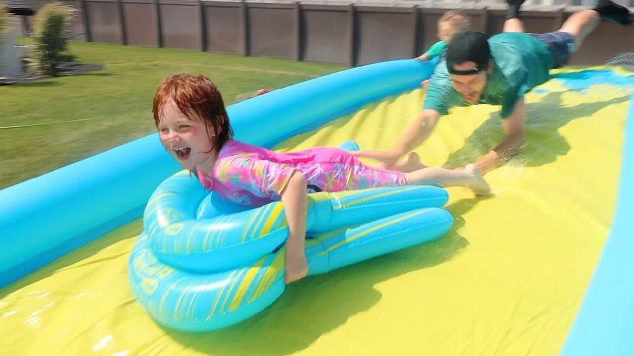 WATER SLiDE x2 with Adley & Niko!!  Ultimate Beach Day swimming at pirate island and the dino story