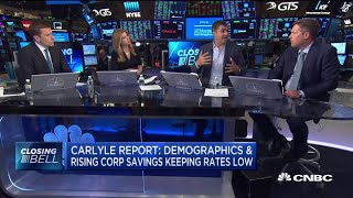 Demographics, corporate savings are keeping rates low: Carlyle report