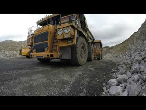 Off-road dump truck in the open pit mine. Mining Industry in 4K