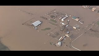 STORM COVERAGE: Levee Breach Floods Hollister Farms