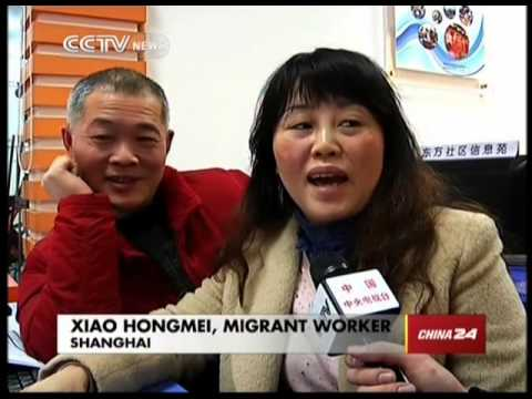 Volunteers help migrant workers book tickets online