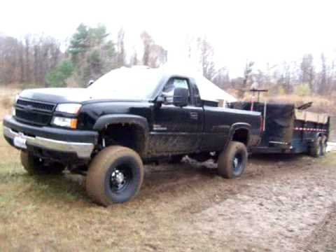 Lifted Duramax Pulling Dump Trailer Out Of Mud Youtube