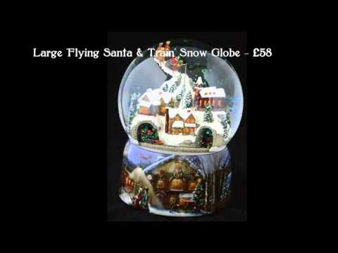 German Musical Snow Globes from Barretts - Large Flying Santa & Train